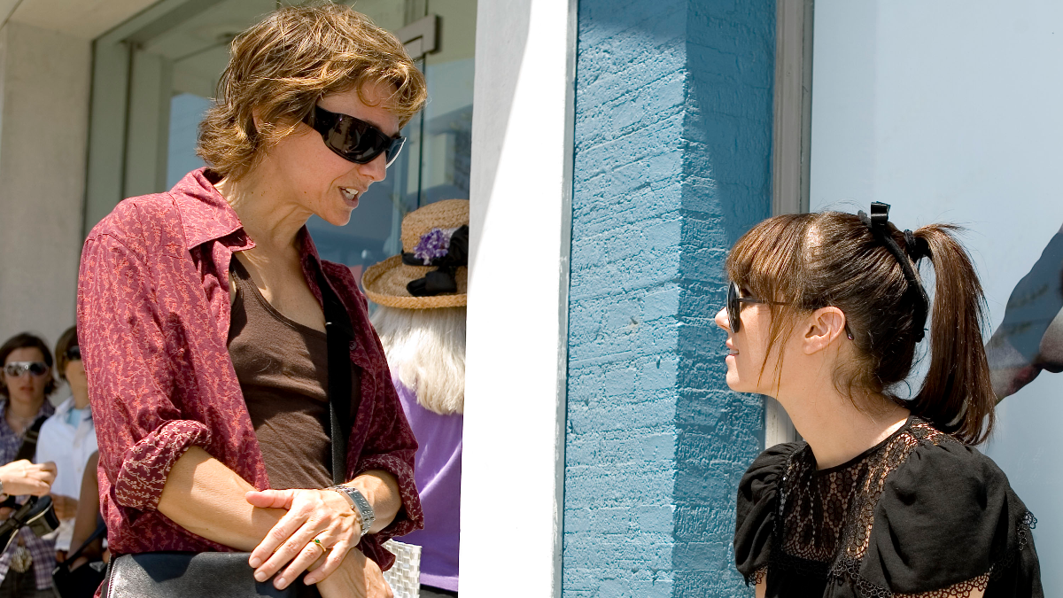 Executive producer and creator Ilene Chaiken, left, and actress Mia Kirshner talk on set in between scenes during filming in Los Angeles of the Showtime original series 'The L Word' in August 2006. (AP Photo/Matt Sayles).