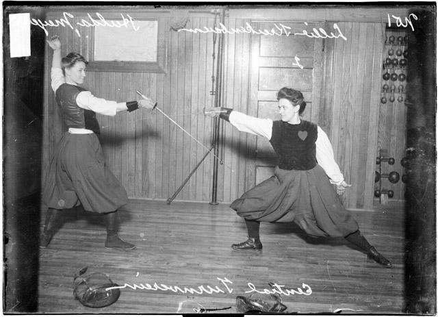 Two members of the Central Turnverein show off a fencing move in 1907.