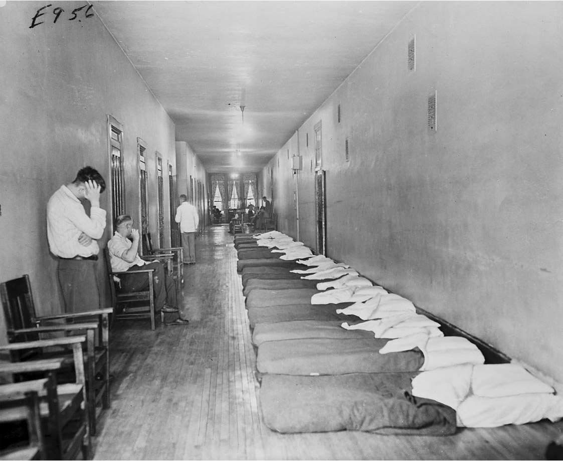 This February 1947 photo, taken inside the Chicago State Hospital, shows the poorly ventilated, narrow and congested hallways where some patients slept. (Chicago Daily News