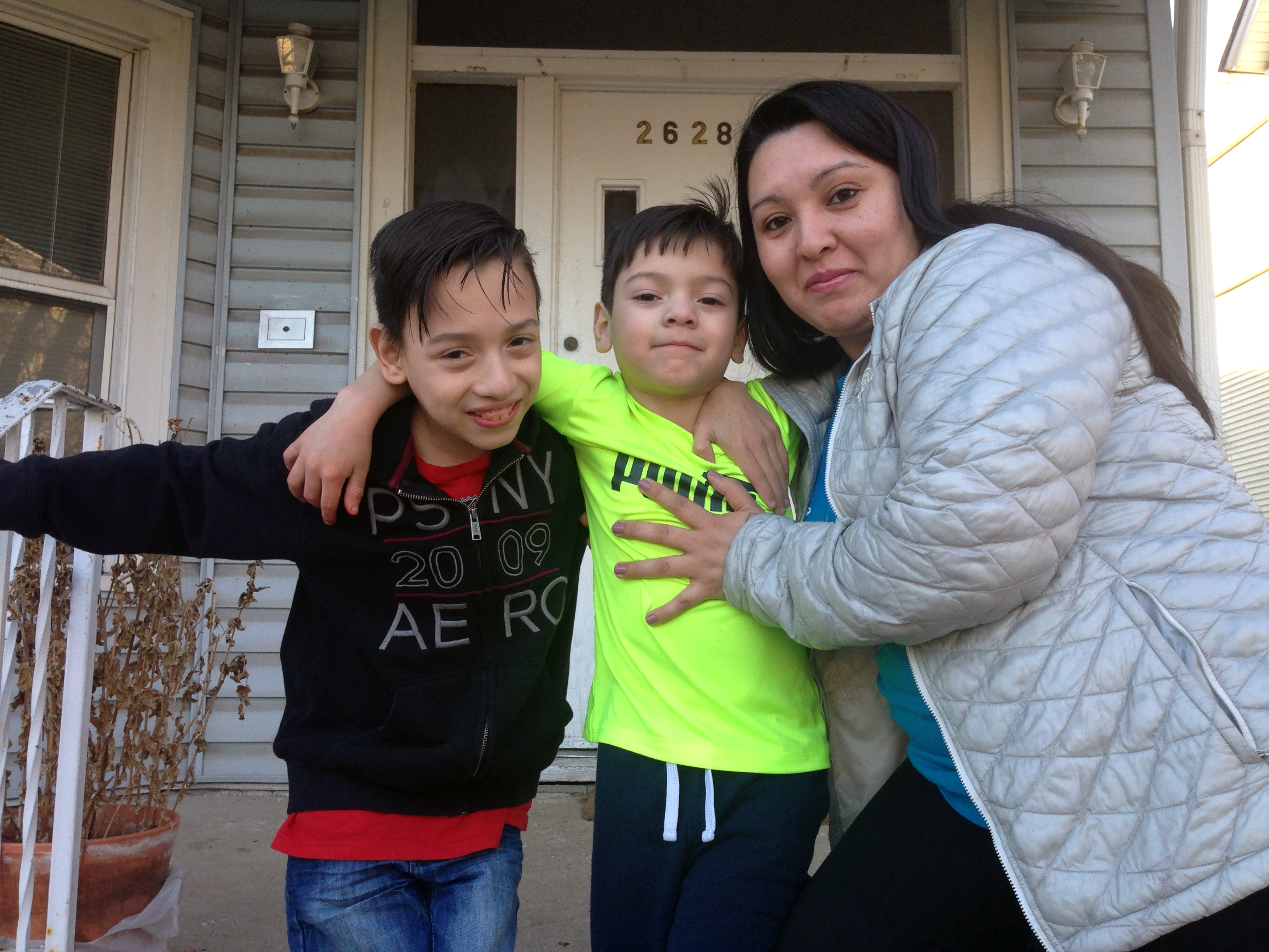 Gabriela Baraja, right, and her sons Melvin Garcia, left, and Antonio Garcia pose for a photo at their home in Chicago on Wednesday, Feb. 22, 2017. (Don Babwin/Associated Press)