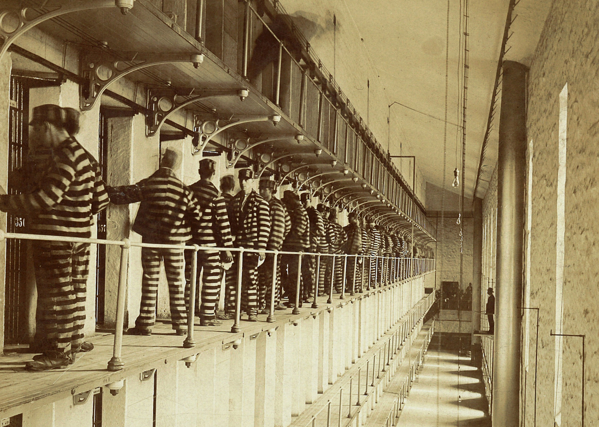 Prisoners line up outside of their cells circa 1890. (Courtesy of the Joliet Area Historical Museum)