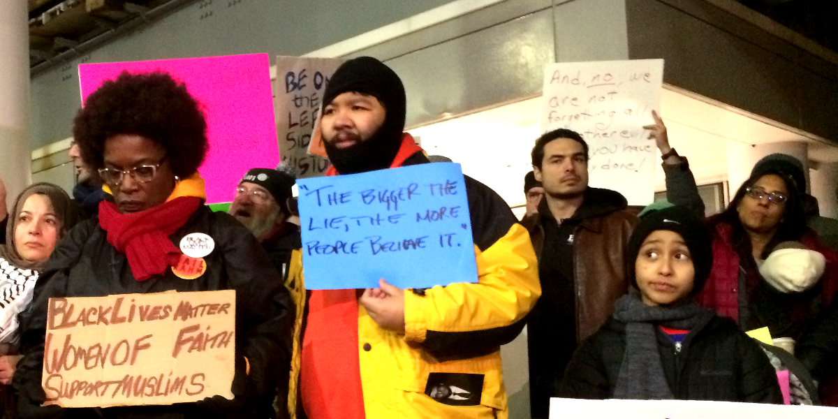 Protesters at O'Hare International Airport in Chicago rally in support of refugees and immigrants on Sunday January, 29, 2017 as President Donald Trump's immigration order sowed more chaos and outrage across the country. (WBEZ/Linda Lutton)