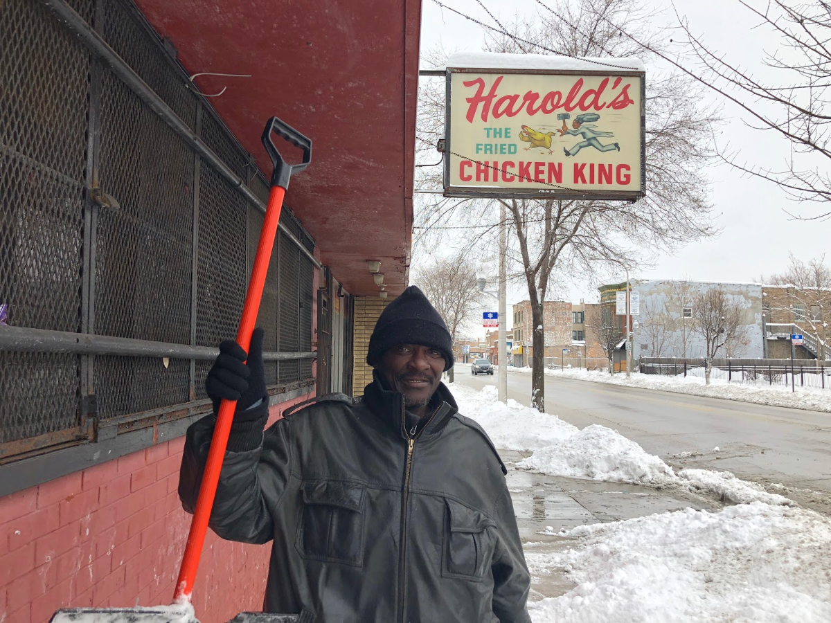 Englewood resident Jimmy Grayson shovels sidewalks Sunday on 63rd and Carpenter streets near an old Harold's restaurant. (Greta Johnsen/WBEZ)