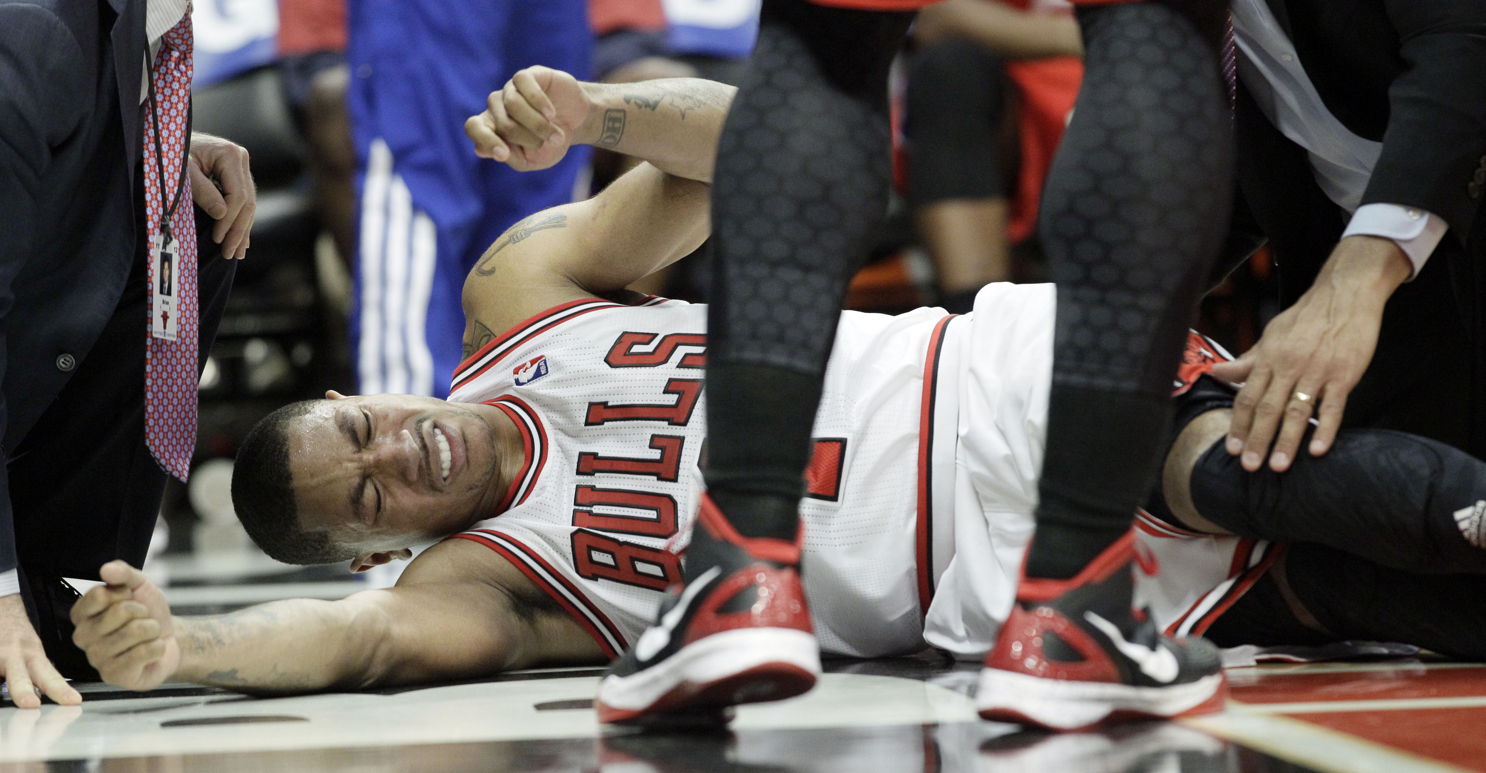 Chicago Bulls guard Derrick Rose reacts after an injury during the fourth quarter of Game 1 in the first round of the NBA playoffs against the Philadelphia 76ers on April 28, 2012. (Nam Y. Huh/Associated Press)