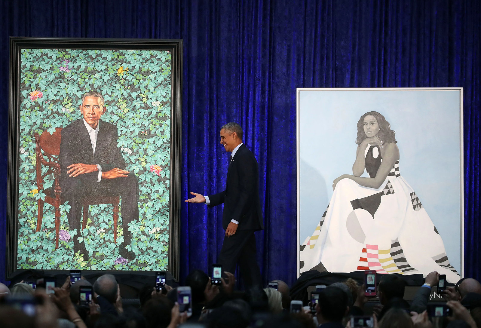 Obama stands between the portraits. His will be permanently installed in the 'America's Presidents' exhibit at the National Portrait Gallery in Washington, D.C. (Mark Wilson/Getty Images)