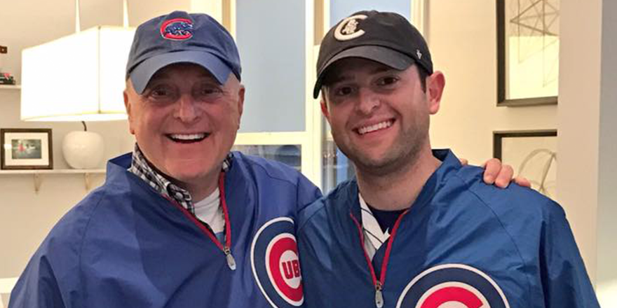Ambassador Bruce Heyman smiles with his son before a Cubs game. (Courtesy of Bruce Heyman)