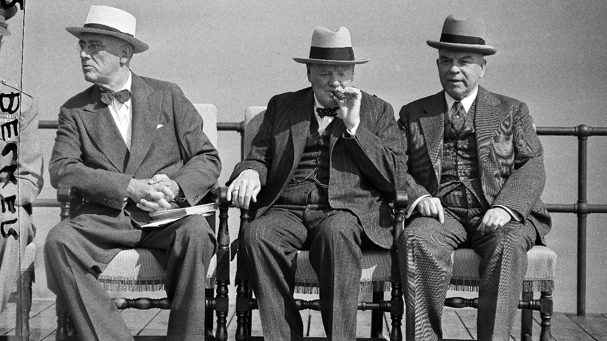 President Roosevelt, left, British Prime Minister Winston Churchill, center, and Canadian Prime Minister Mackenzie King, chat on the terrace of the Citadel in Quebec City, Canada, Sept. 12, 1944. (AP Photo/Murray Becker)