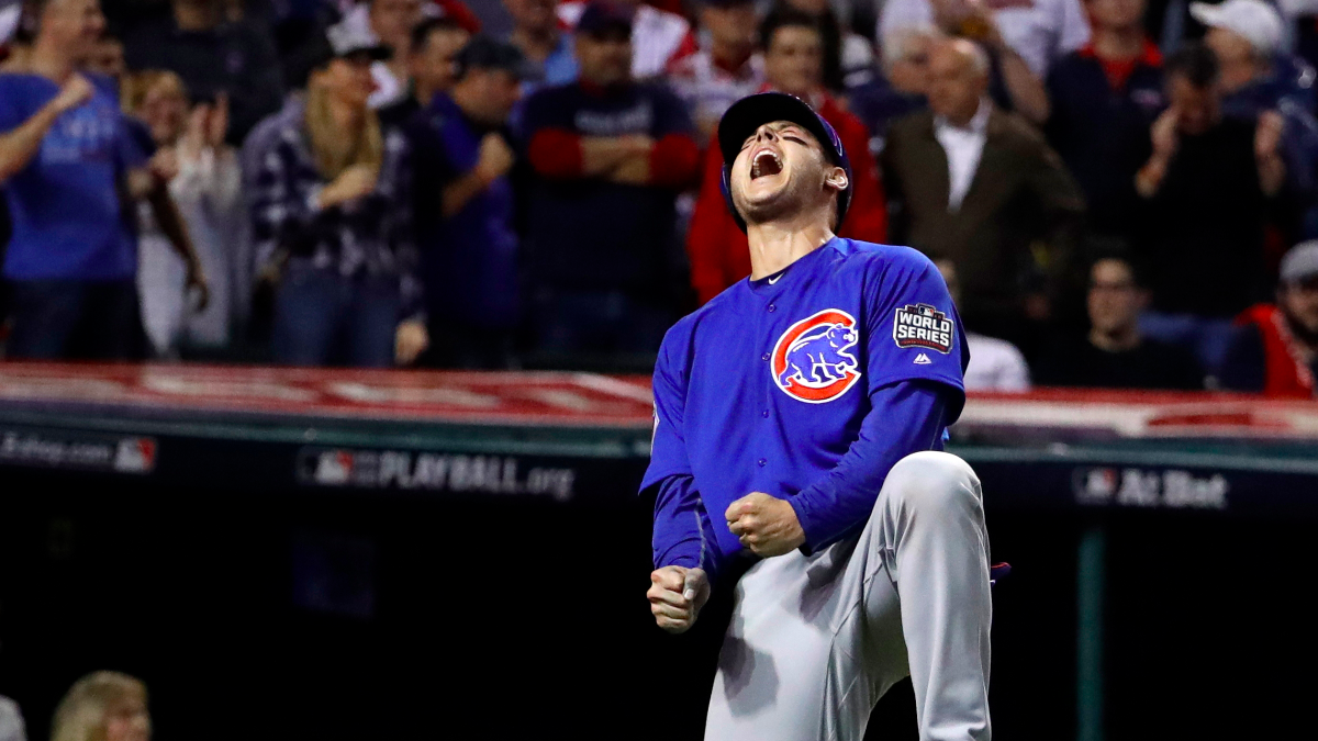 Chicago Cubs' Anthony Rizzo reacts after scoring on a hit by Miguel Montero during the 10th inning of Game 7 of the Major League Baseball World Series against the Cleveland Indians Wednesday, Nov. 2, 2016, in Cleveland. (David J. Phillip/AP Photo)