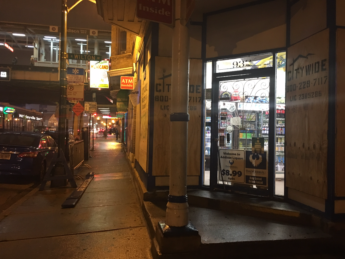 A convenience store boarded up its windows to prevent rowdy baseball fans from breaking them. (Hunter Clauss/WBEZ)