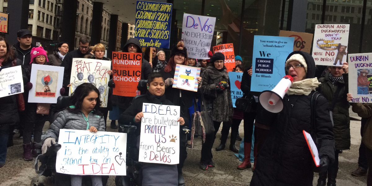 Parents and community leaders on Tuesday urged U.S. Senators Dick Durbin and Tammy Duckworth to vote against DeVos' nomination as education secretary. (Linda Lutton/WBEZ)