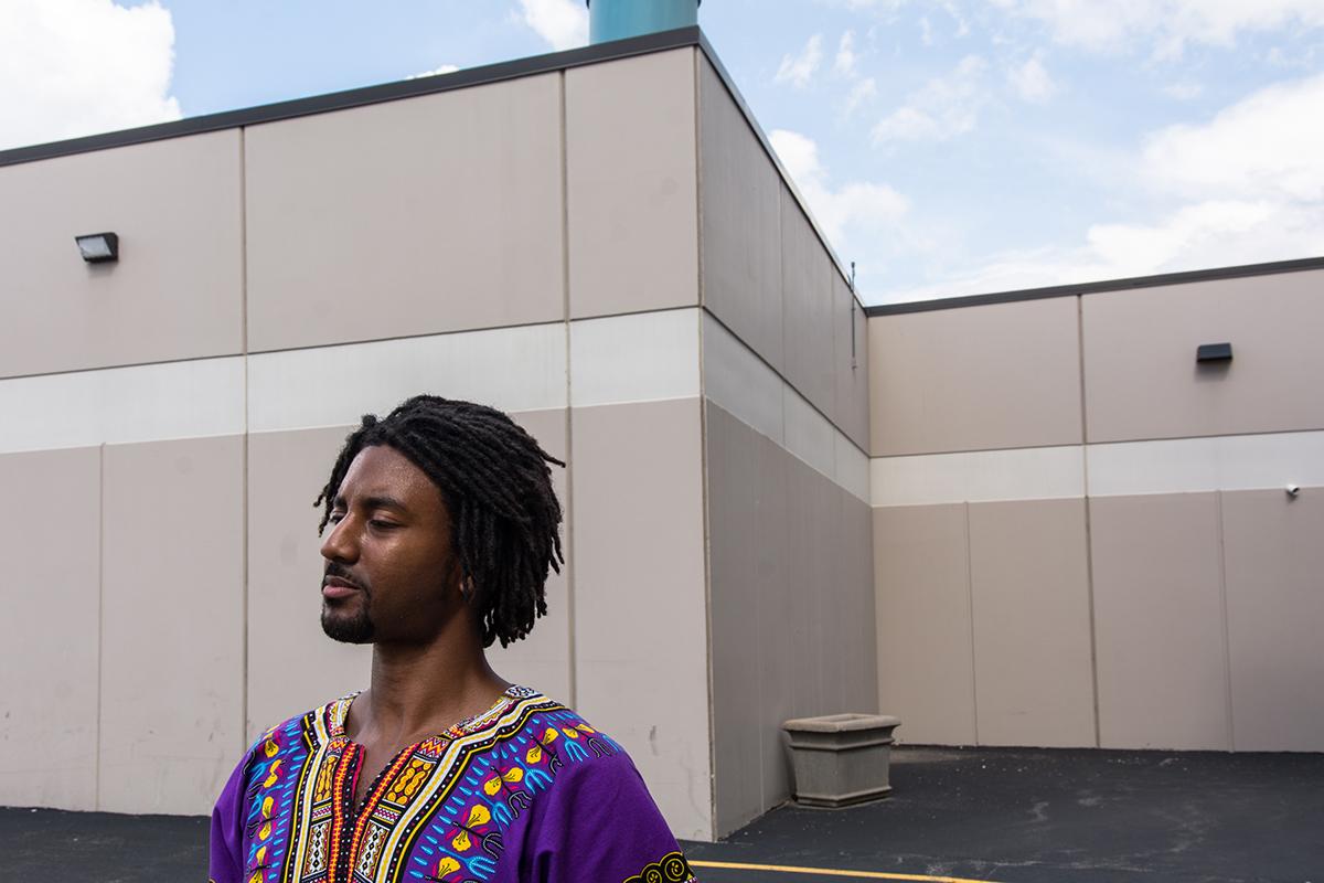 Ernest Crim outside Joliet Central High School, where he is a teacher.  (Sebastián Hidalgo/WBEZ)