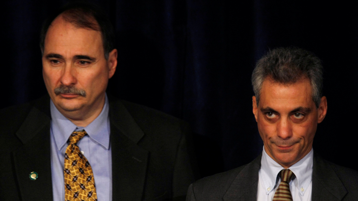 In 2008, Rahm Emanuel, right, then President-elect Barack Obama's chief of staff, and senior advisor David Axelrod, listen during a news conference in Chicago. (Gerald Herbert/AP)
