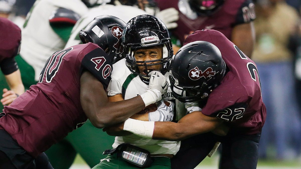 High school players compete during the Texas UIL 5A Division I state high school championship football game in Houston in 2015. (AP Photo/Bob Levey)