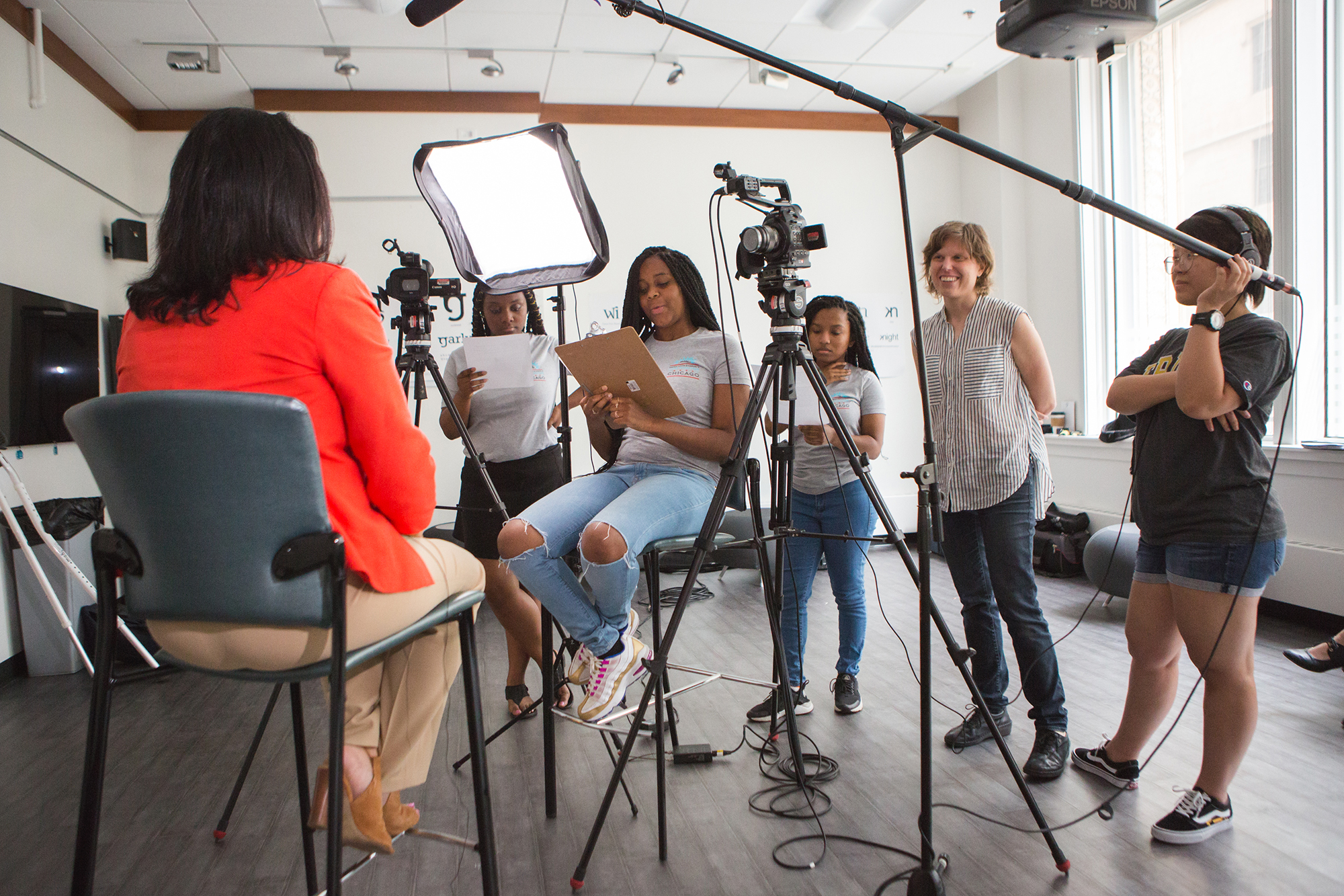Program participants interview an expert for their documentary with guidance from DePaul faculty and graduate students.