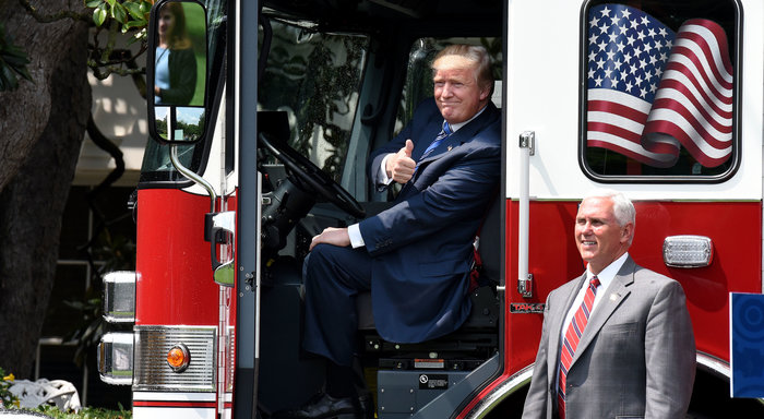 President Trump sits inside a firetruck from a Wisconsin-based manufacturer for a 'Made in America' event on the South Lawn of the White House on Monday. Later in the day, enough Senate Republicans voiced opposition to their party's health bill that it could not move forward. (Olivier Douliery/AFP/Getty Images)
