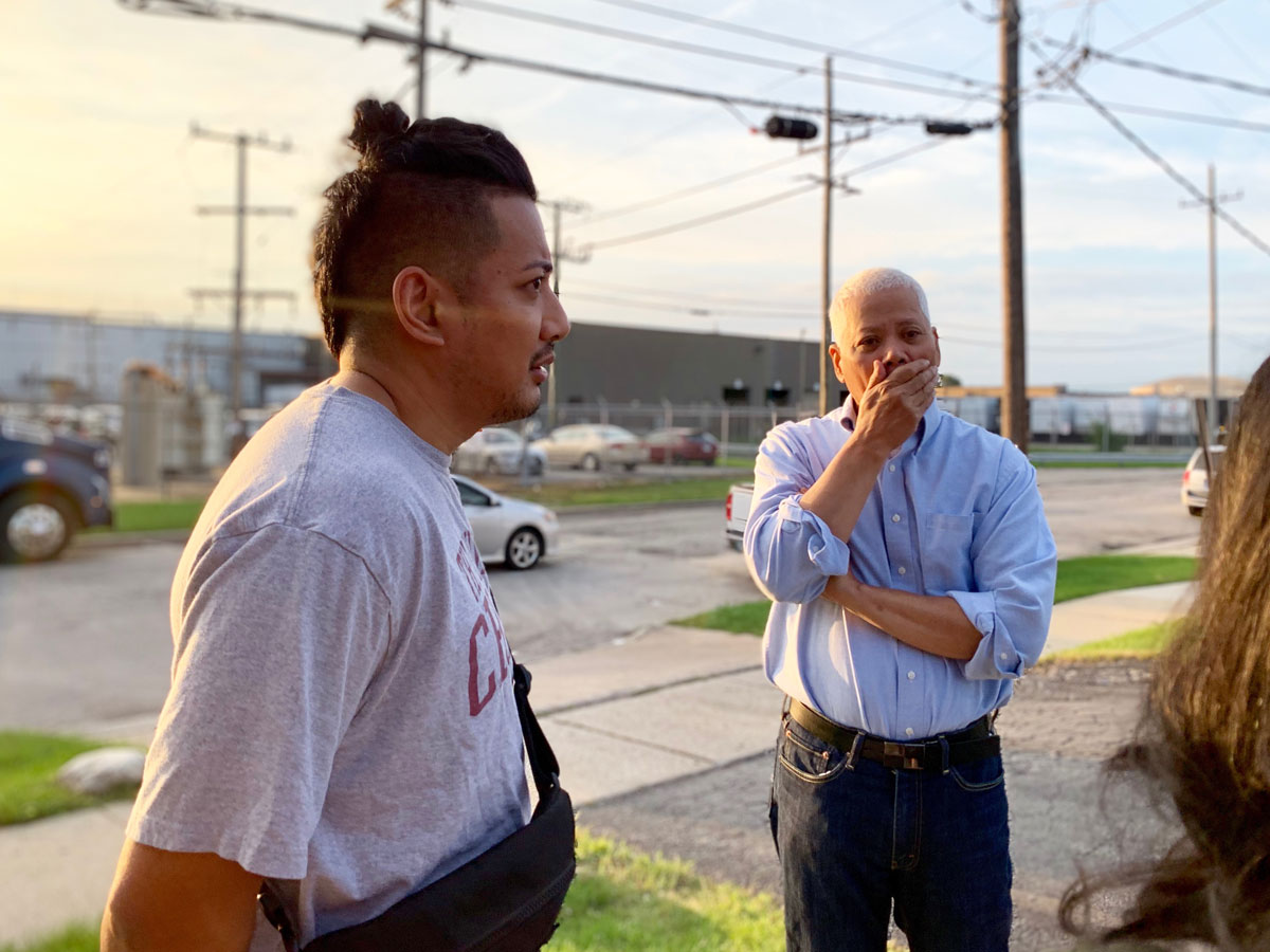 Aaron and Edgardo Bartolome wait to visit with Julie on the morning of her deportation.
