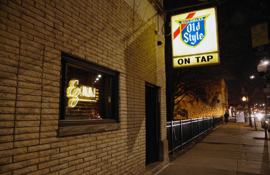 The amber glow of the Old Style sign outside EZ Inn in the Ukrainian Village neighborhood. (Courtesy John Fecile)