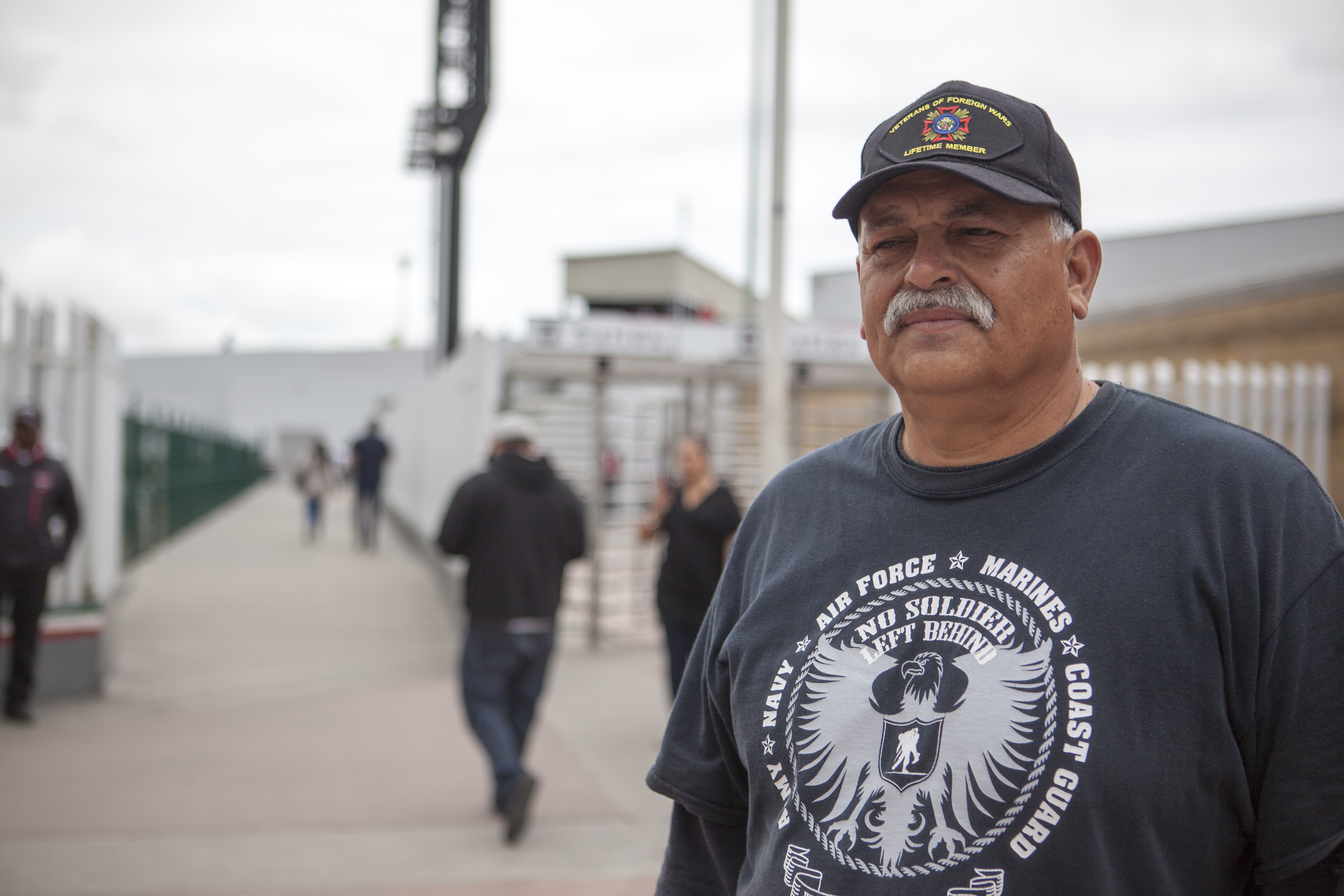 Hector Lopez, director of the organization Unified U.S. Deported Veterans, stands outside the walkway where deportees arrive in Tijuana, Mexico on May 7, 2019.