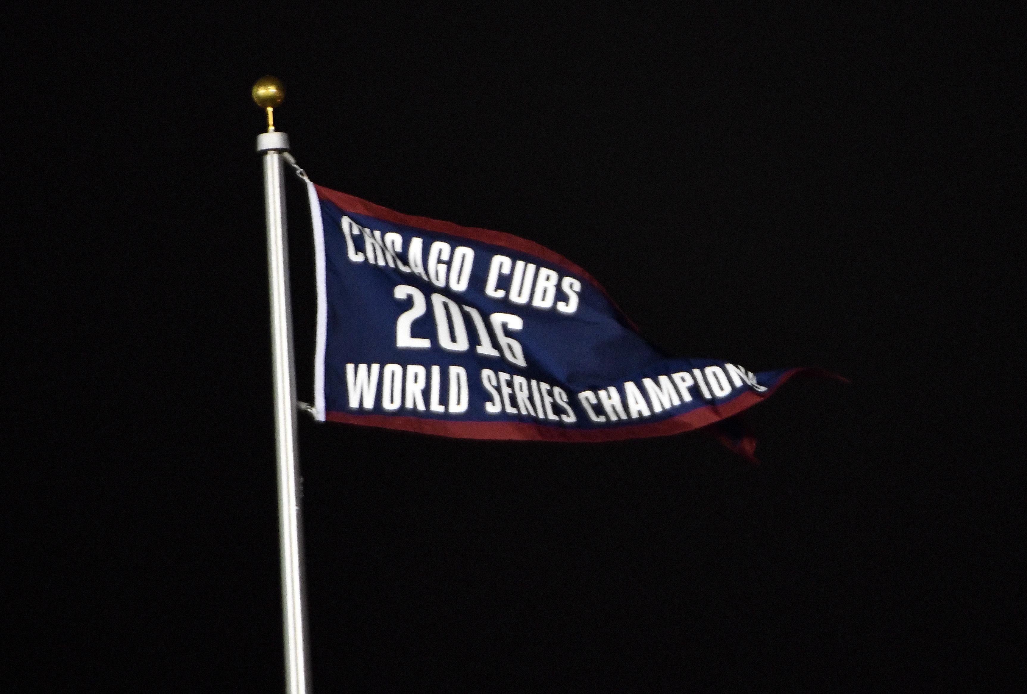 The Chicago Cubs raised their 2016 World Series Championship Flag Monday. (AP Photo/David Banks)