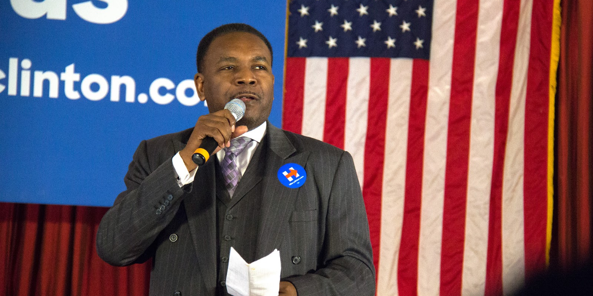 Rev. Ira Acree of the Greater St. John Bible Church speaks at a February 2016 rally for Hillary Clinton rally at the Parkway Ballroom. Acree says disinvestment on the West Side has contributed to increased gun violence.