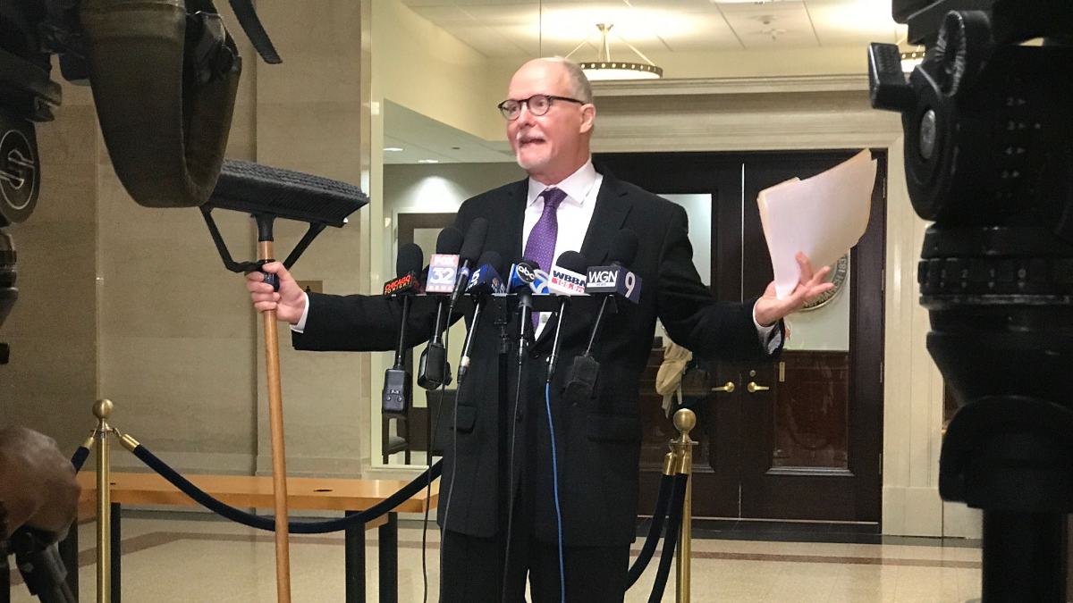 "Holding a broom to ""clean up"" City Hall, mayoral candidate Paul Vallas says Burke's indictment is just politics as usual."" At the end of the day, we got to vote the bums out. It's as simple as that."" (Claudia Morell/WBEZ)"