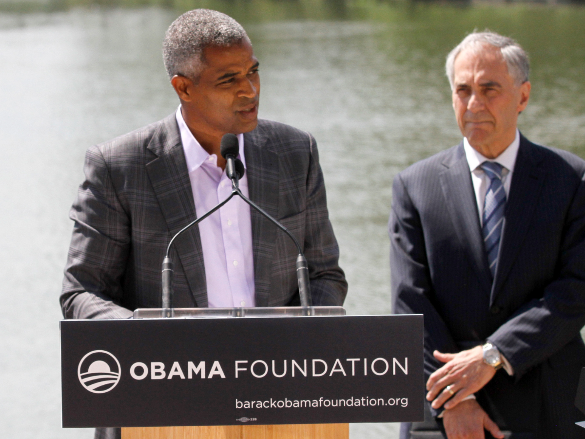 Marty Nesbitt, left, chair of the Obama Foundation is accompanied by Robert J. Zimmer, president of University of Chicago at a 2016 news conference to officially announce Jackson Park as the site of the Obama Presidential Center. (AP Photo/Tae-Gyun Kim)