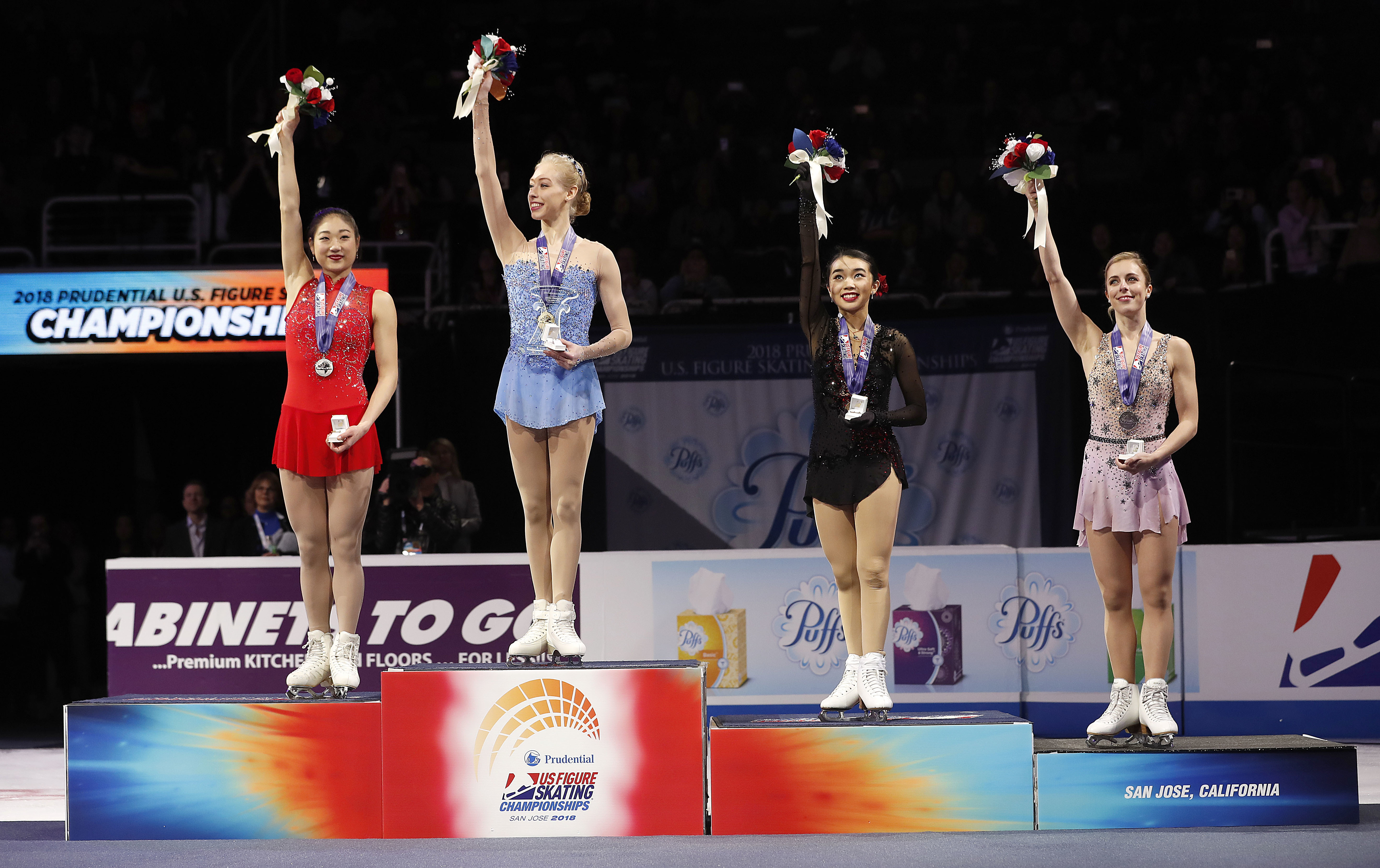 Bradie Tennell, second from left, poses after winning the women's free skate event with second place finisher Mirai Nagasu, left, third place finisher Karen Chen, second from right, and fourth place finisher Ashley Wagner at the U.S. Figure Skating Championships in San Jose, Calif., Friday, Jan. 5, 2018. (AP Photo/Tony Avelar)