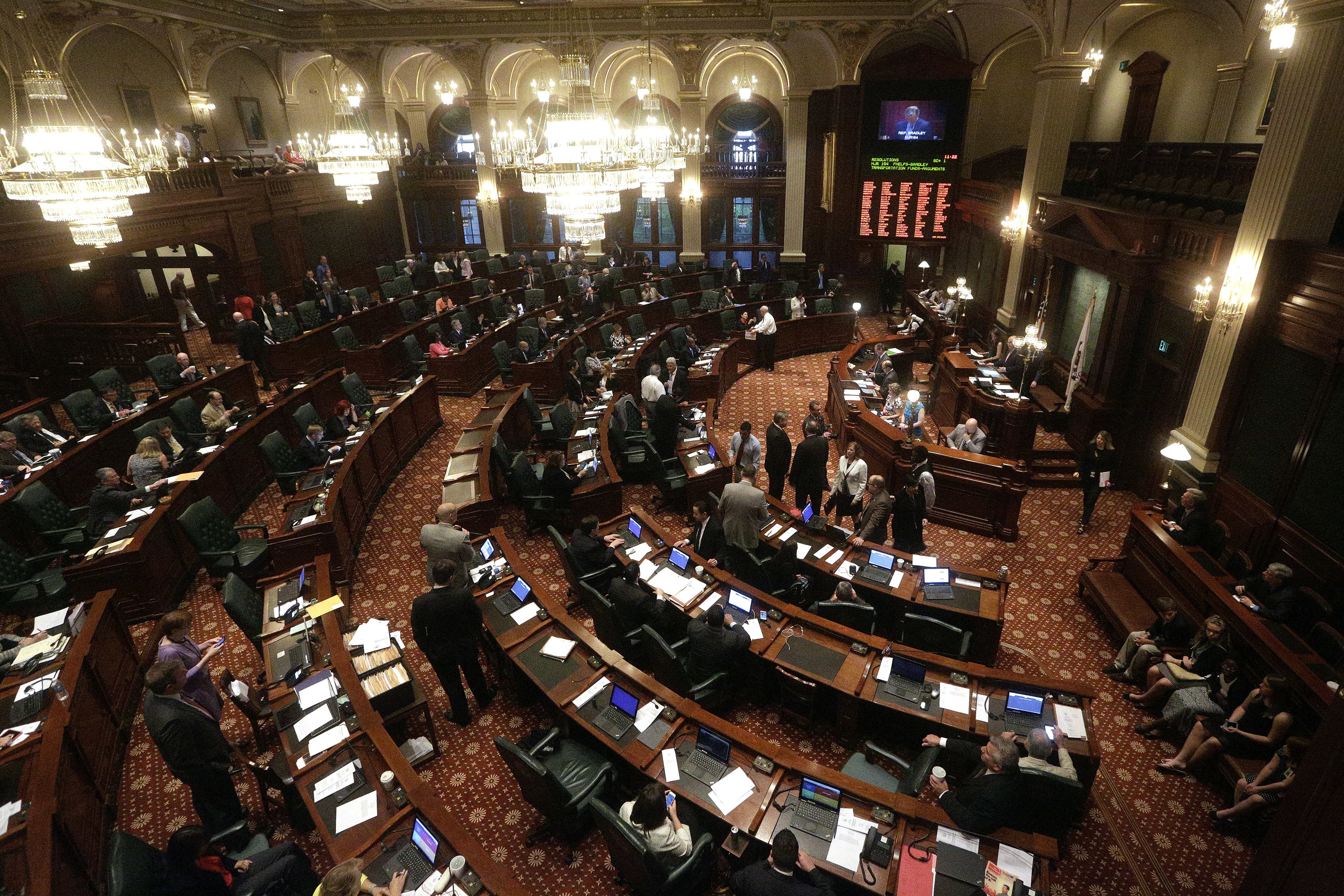 Illinois representatives gather on the House floor during session at the Illinois State Capitol Tuesday, May 31, 2016, in Springfield, Ill. (AP Photo/Seth Perlman)