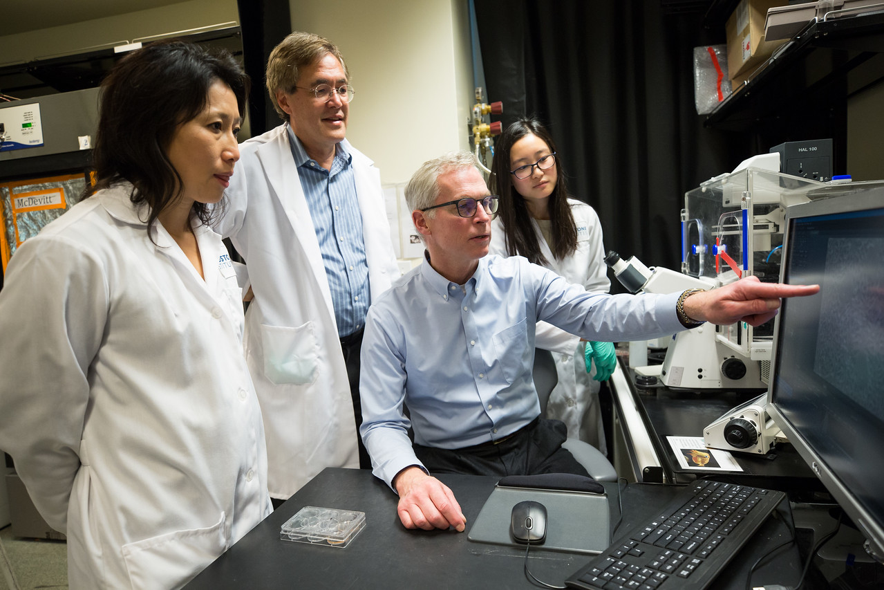 Greta's father, Jim Johnsen, seated, meets with Po-Lin So PhD, Bruce Conklin MD, and research associate Angela Liu at the Gladstone Institutes, a research institution affiliated with the University of California, San Francisco. (Photo courtesy of the University of California, San Francisco)