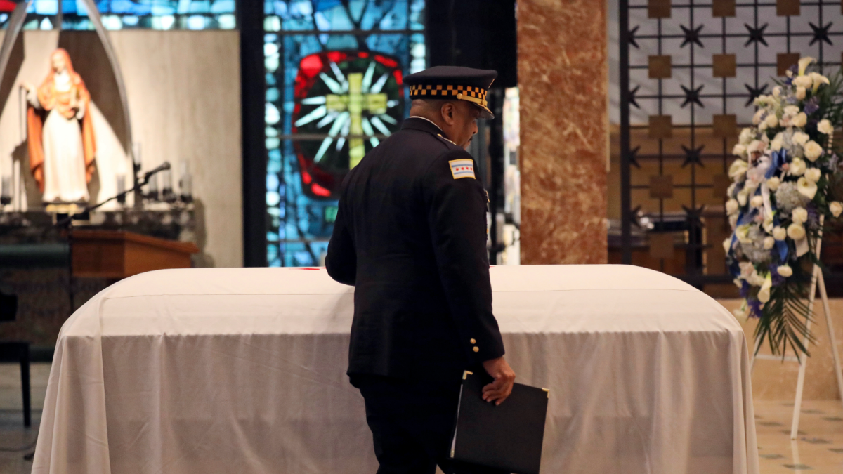 Chicago Police Superintendent Eddie Johnson pauses at the casket during the funeral for Officer Conrad Gary. (Abel Uribe/Chicago Tribune via AP, Pool)