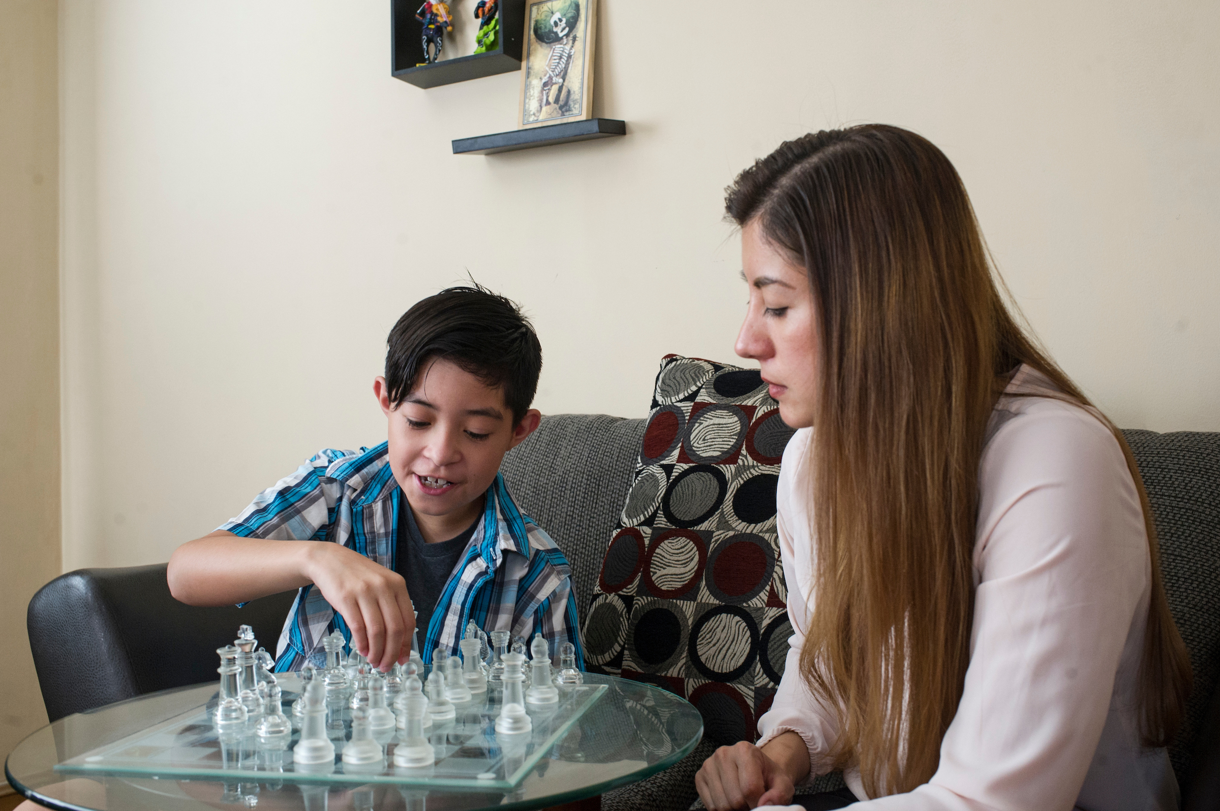 Julie Rodriguez and her son play a game of chess. (Marc Monaghan for WBEZ)