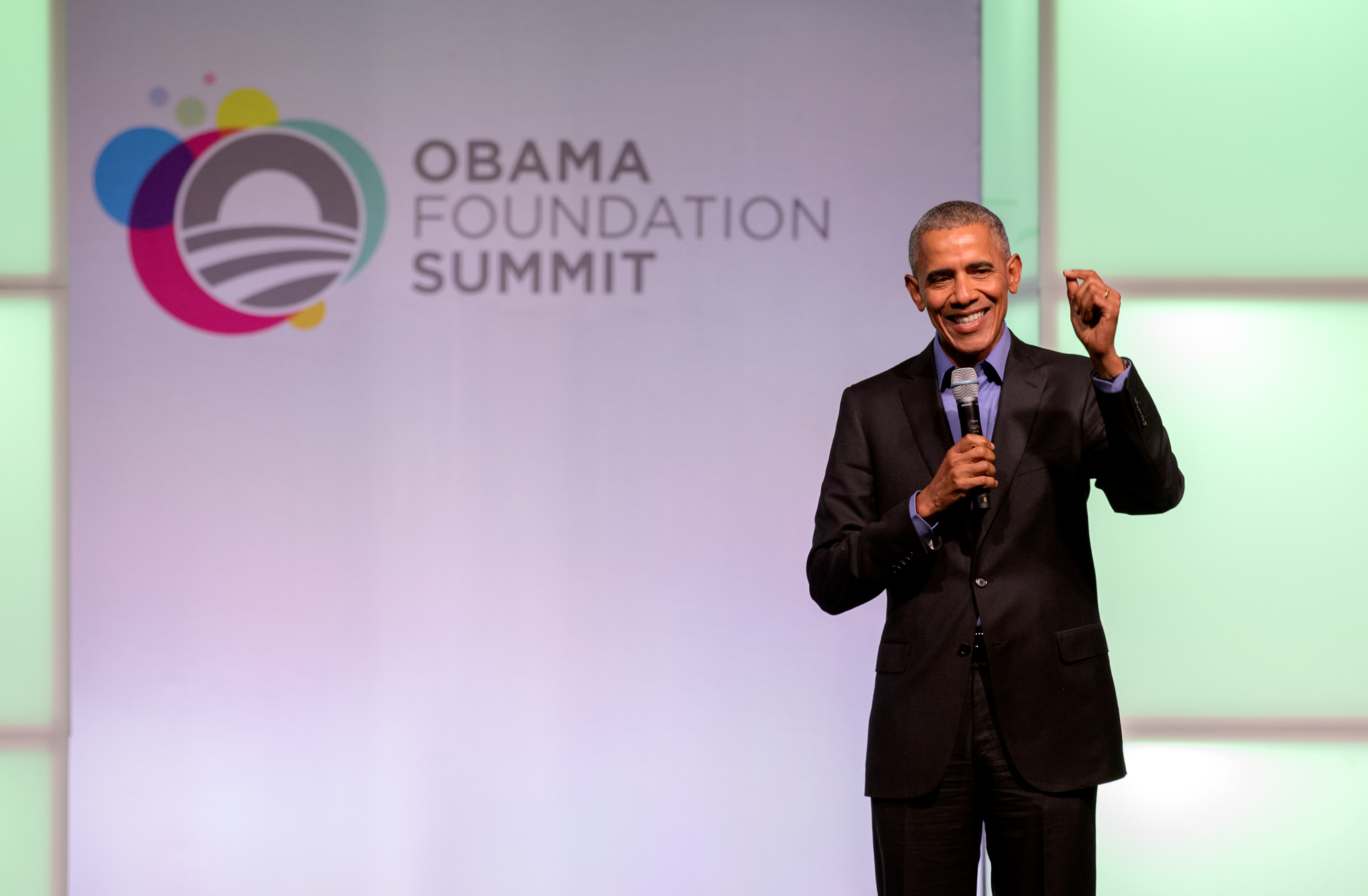 Former President Barack Obama speaks onstage at the closing session for the inaugural Obama Foundation Summit in Chicago on Wednesday, Nov. 1. (Andrew Gill/WBEZ)