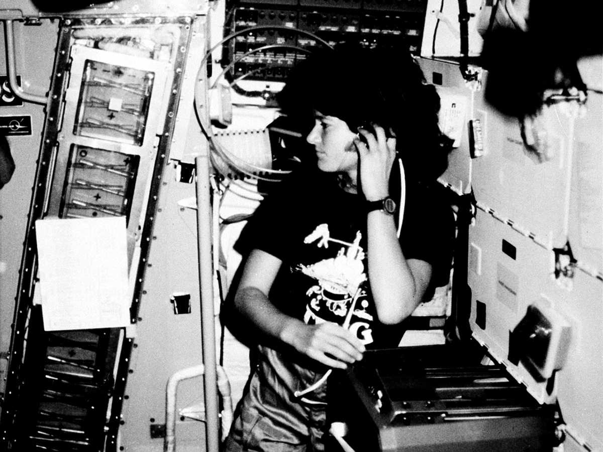 Astronaut Sally Ride, STS-7 mission specialist, communicates with ground controllers from the mid-deck of the earth-orbiting Space Shuttle Challenger in June 1983. (AP Photo/NASA)