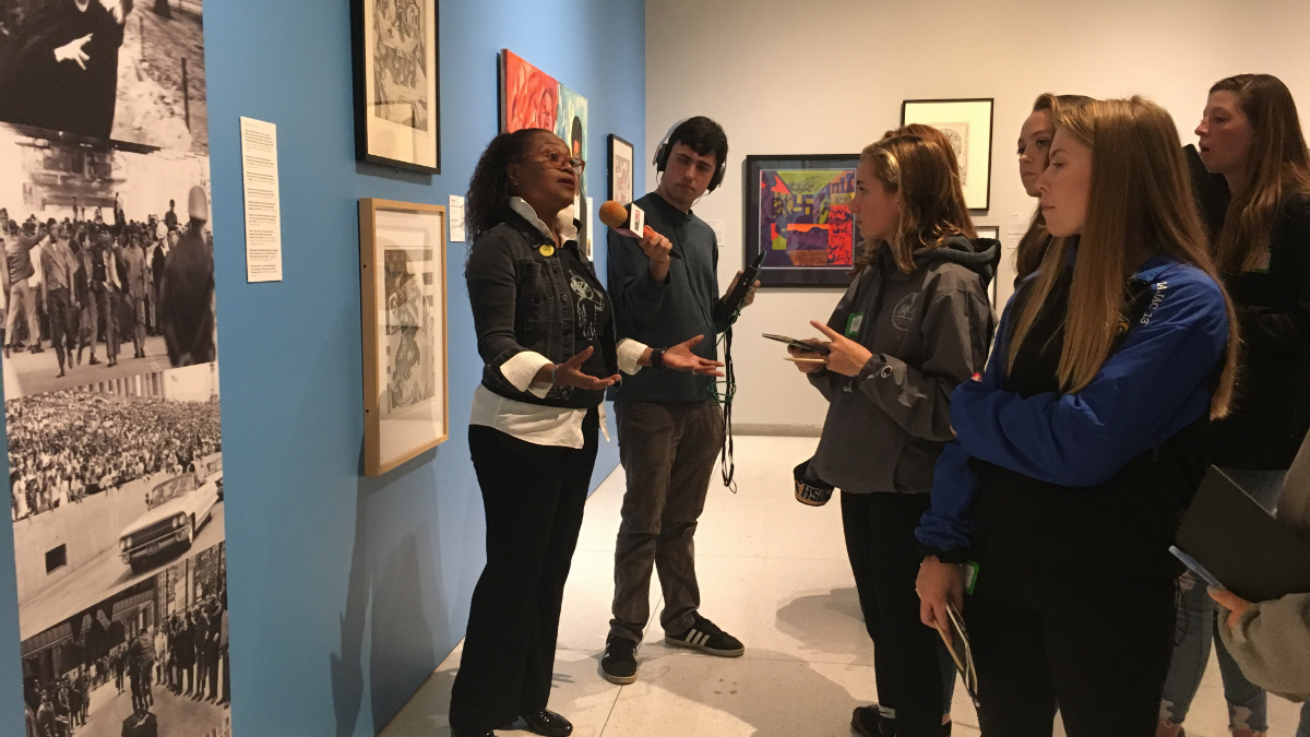 Smart Museum docent Nicole Bond leads a tour group from Taft High School. The tour became interactive as some students shared their research on paintings and photographs from the museum. (Jason Pallas/Smart Museum of Art)