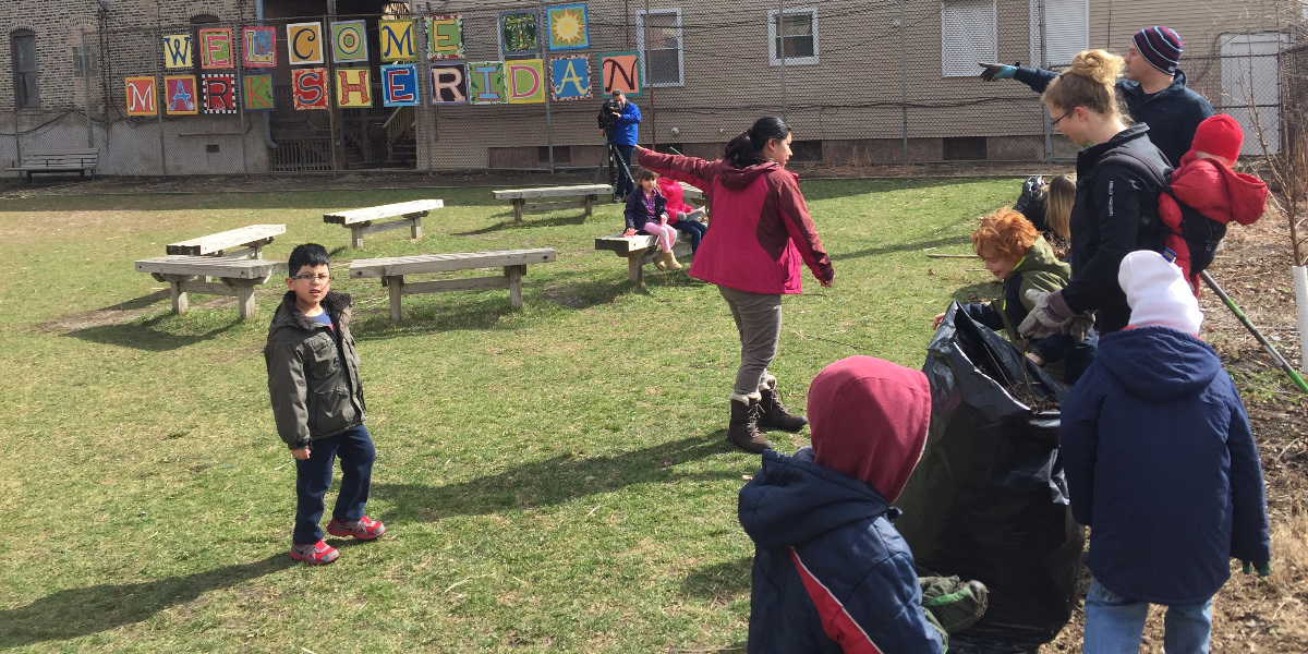 Parents at Sheridan Math and Science Academy help clean the school's garden on a Chicago Public Schools furlough day, where the district made all employees take an unpaid day off.