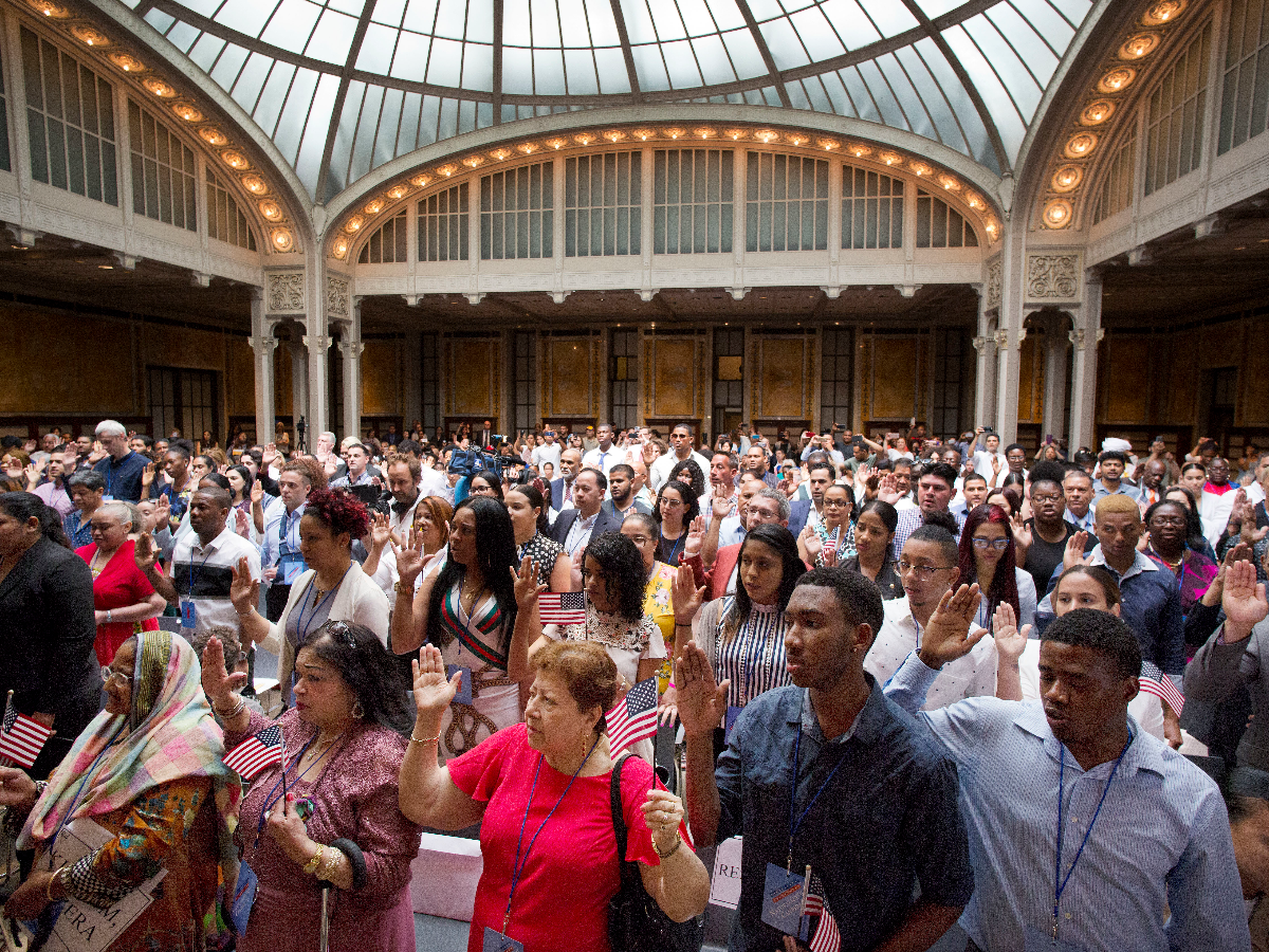 MTwo hundred immigrants from 50 countries take the oath of citizenship in a naturalization ceremony, on July 3, 2018, at the New York Public Library's Celeste Bartos Forum. (AP Photo/Mark Lennihan).