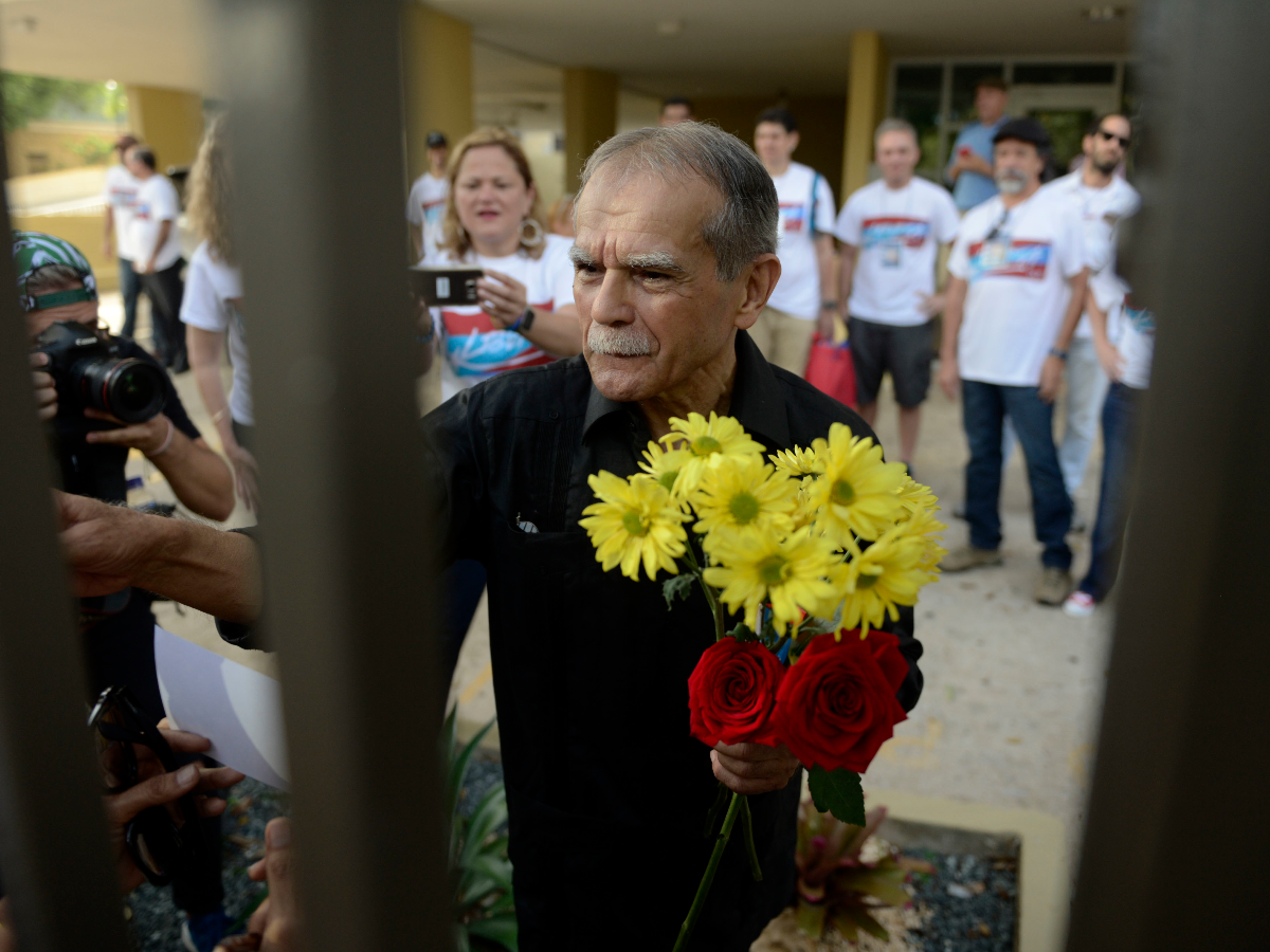 Oscar Lopez Rivera greets well wishers as he is released from home confinement after 36 years in federal custody, in San Juan, Puerto Rico on Wednesday. (Carlos Giusti/Associated Press)
