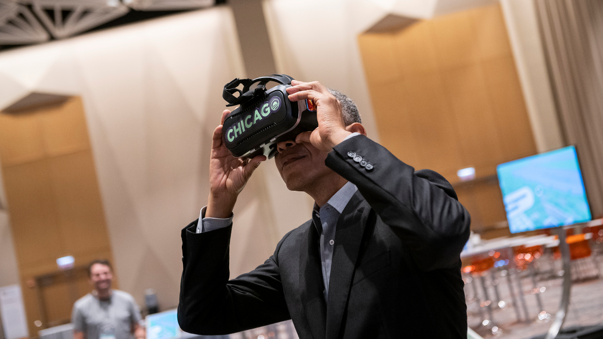 President Barack Obama views the Obama Presidential Center Model using a VR headset. (The Obama Foundation)