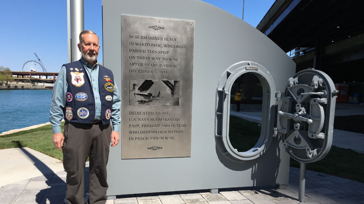 Chris Gaines, a submarine veteran with the group Crash Dive Base, at the new memorial on the Chicago Riverwalk.