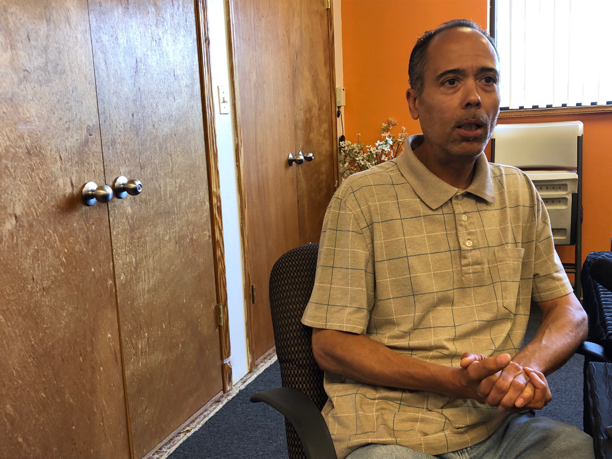 Nasir Blackwell, himself a former prisoner, said housing is the most important factor in determining whether a former prisoner will be successful. Blackwell is seen here sitting in a conference room at the Inner-City Muslim Action Network in Chicago.