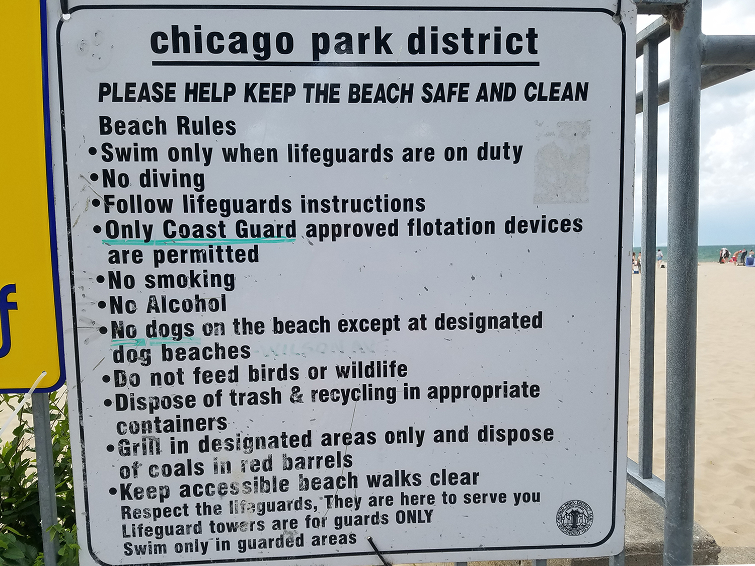 A sign explains that only Coast Guard approved flotation devices can be worn at the beach. (WBEZ/Monica Eng)