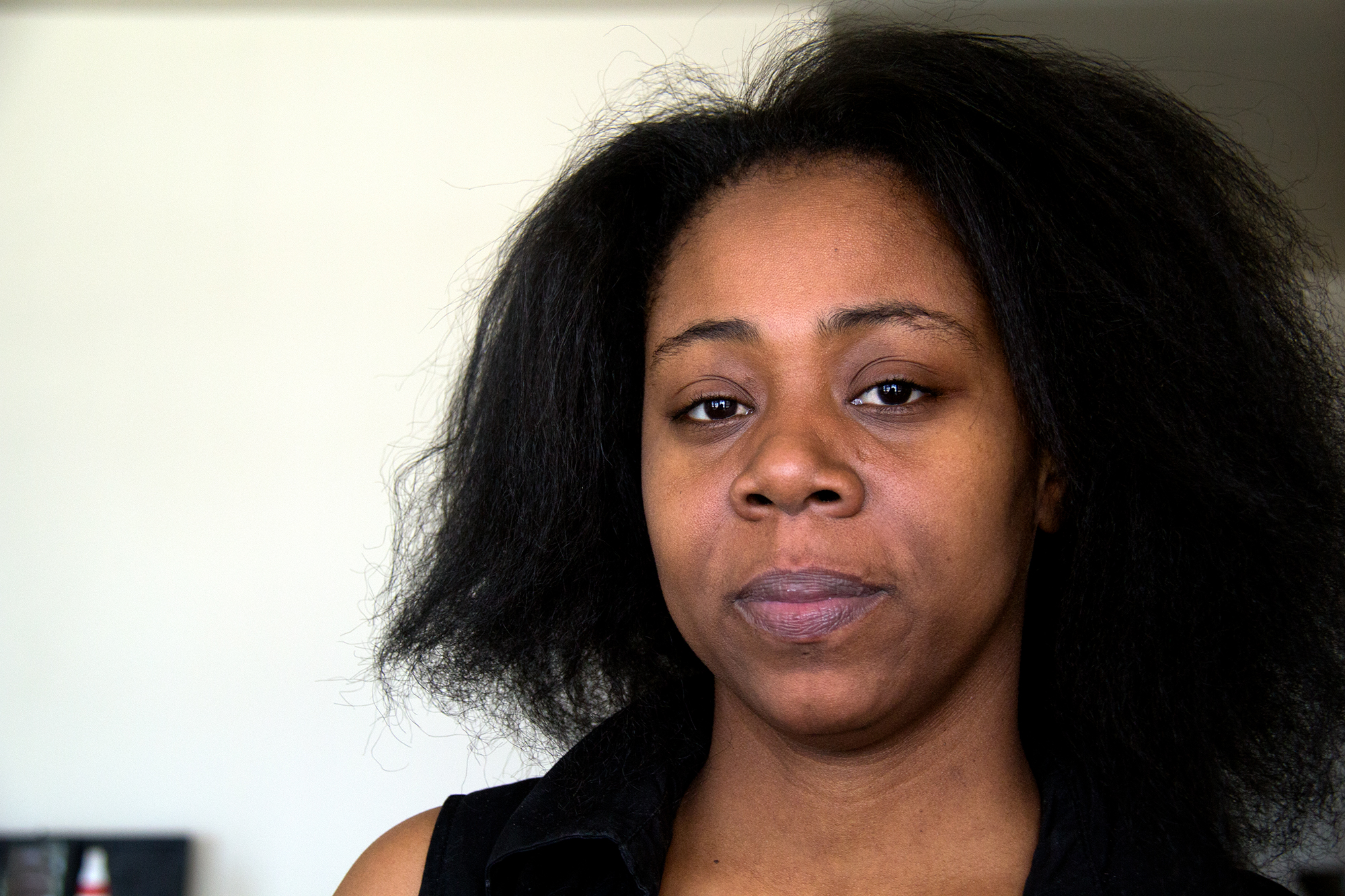 Kyisha Weekly talks about Candice Curry, who was fatally shot in 1998 at age 13. (WBEZ / Gabrielle Wright)