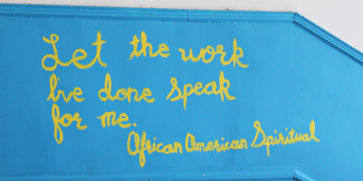 Burke Elementary's brightly painted walls are filled with quotes, artwork, and photos. (Arionne Nettles/WBEZ)