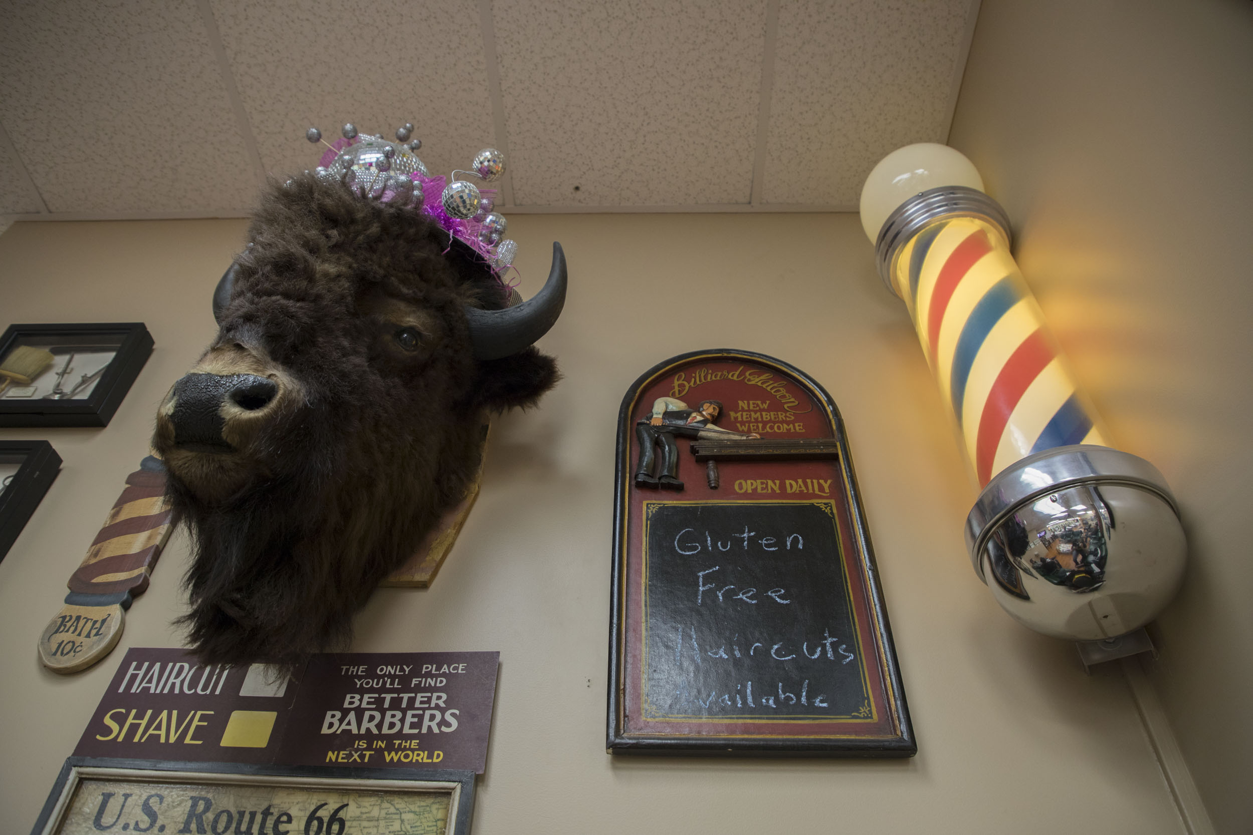 Whimsical decor in the waiting area at Father and Son barbershop. (Andrew Gill/WBEZ)