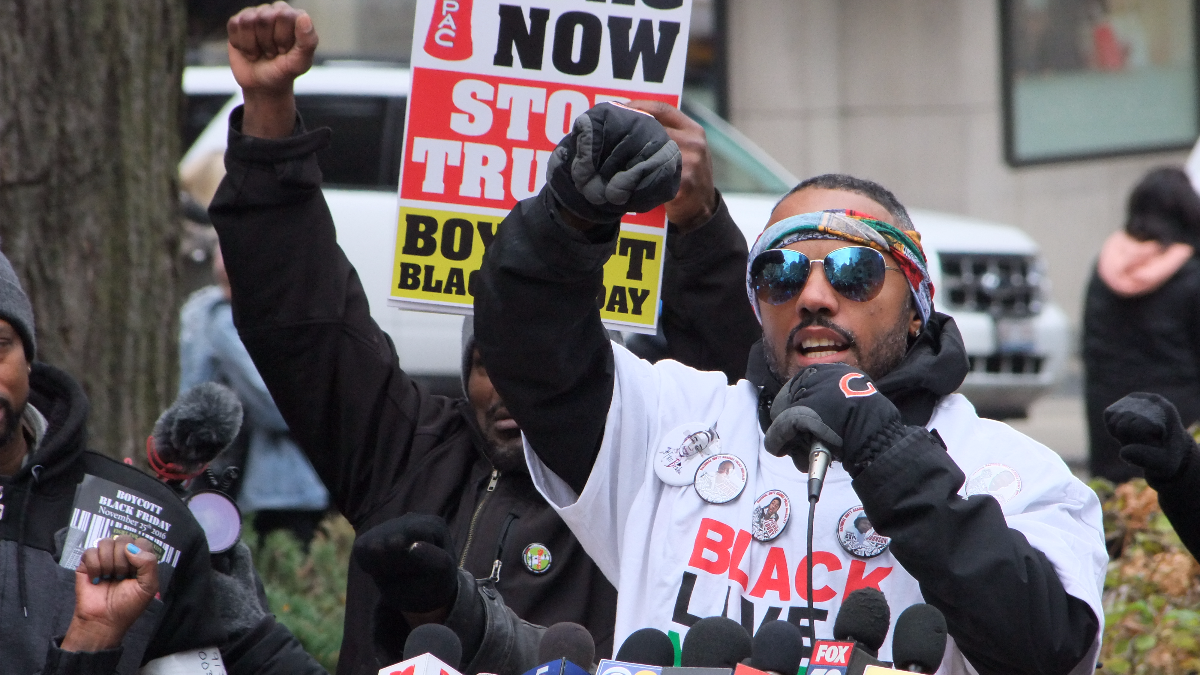 Kofi Ademola of Black Lives Matter Chicago speaks at a rally in the Magnificent Mile shopping district on Friday. Protestors were calling for an elected civilian police review board. (Courtesy of Seth Gilbert)