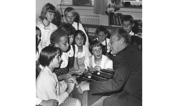 German composer Carl Orff pioneered an approach to music education that emphasized improvisation and exploration. In 1964, he demonstrated his teaching style with children in Diessen, Germany. (Courtesy Carl-Orff-Stiftung)