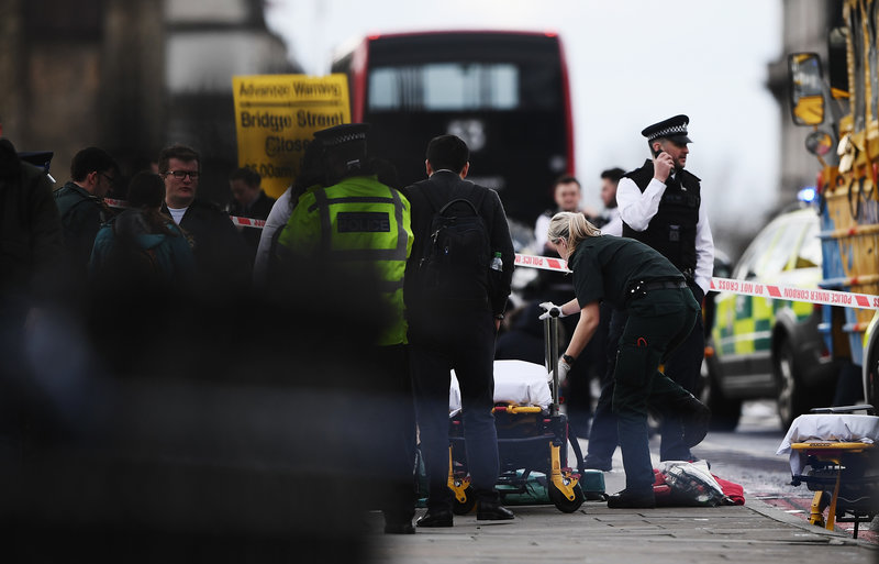 Medical staff near Westminster Bridge on Wednesday in London, where the U.K. House of Commons is under lockdown. (Carl Court/Getty Images)