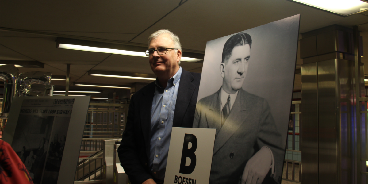 The CTA gave Peter Boesen a poster designed like vintage train signs to honor his grandfather Peter J. Boesen. Peter J. Boesen was the chief engineer for the State Street subway and studied train systems in cities like Toronto.(Ambriehl Crutchfield/WBEZ)