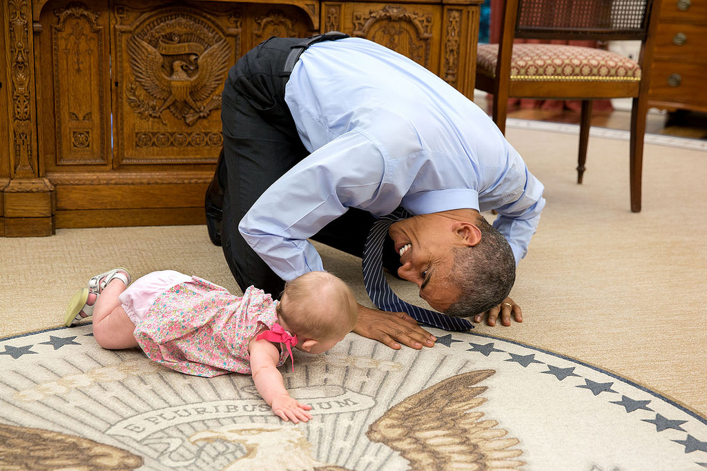 At the President's insistence, Deputy National Security Advisor Ben Rhodes brought his daughter Ella by for a visit on June 4, 2015. As she was crawling around the Oval Office, the President got down on his hands and knees to look her in the eye. (Official White House Photo by Pete Souza)