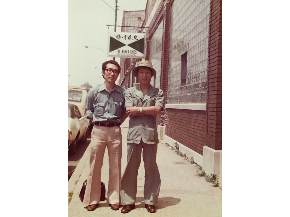 Veteran Korean journalists Kwang Dong Jo (left) and Byung Chan Ahn (right) stand in front of the Korea Times building on Clark Street. (Courtesy of Kwang Dong Jo)
